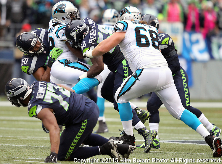 Seattle Seahawks linebackers K.J. Wright (50) and Kevin Pierre-Louis (56) unbends  Carolina Panthers  running back Jonathan Stewart (28)  at CenturyLink Field in Seattle on October 18, 2015. The Panthers came from behind with 32 seconds remaining in the 4th Quarter to beat the Seahawks 27-23.  ©2015 Jim Bryant Photography. All Rights Reserved.