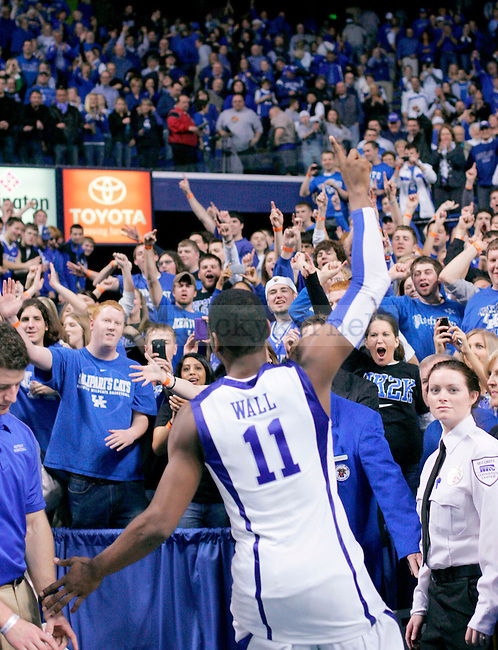 Freshman guard John Wall runs off the court holding up one finger after their 101-70 victory over Arkansas  at Rupp Arena on Saturday. The Cat's are now the No. 1 team in the nation. Photo by Zach Brake | Staff..