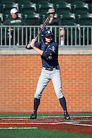 Ethan Schmidt (16) of the Xavier Musketeers at bat against the Charlotte 49ers at Hayes Stadium on March 3, 2017 in Charlotte, North Carolina.  The 49ers defeated the Musketeers 2-1.  (Brian Westerholt/Four Seam Images)