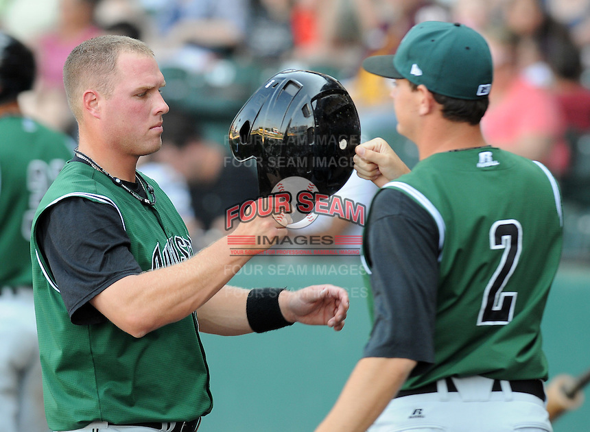 Catcher Dan Burkhart (15) of the Augusta GreenJackets is congratulated after scoring a run in a game against the Greenville Drive on April 10, 2011, at Fluor Field at the West End in Greenville, S.C. Photo by Tom Priddy / Four Seam Images