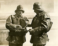 BNPS.co.uk (01202 558833)<br /> Pic: LondonNewsAgency/BNPS<br /> <br /> Brave Scottish coxswain's John Campbell and John Swanson compare medals at the 1932 AGM.<br /> <br /> Splash in the Attic...<br /> <br /> A 'lost' cache of 13,000 photographs charting the history of the RNLI has been found in the attic of the charity's headquarters.<br /> <br /> Many of the black and white photos date back to the 1920s and '30s long before the terms 'health and safety' and 'risk assessment' were thought of.<br /> <br /> One image depicts a brave lifeboatman dressed in a suit and cloth cap just as the lifeboat he is on launches down a ramp into a choppy sea.<br /> <br /> Another shows the crew of another open lifeboat getting swamped by waves with only their souwesters and lifejackets to protect them.<br /> <br /> The photos have been unearthed in storage space at the RNLI HQ in Poole, Dorset, and they are now being digitised.