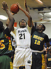 Marcus Jasmin #21 of Baldwin looks to drive to the net as Isaiah Bien-Aise #12 of Westbury, right, contests his shot during a Nassau County AA-2 varsity boys basketball game at Baldwin High School on Tuesday, Jan. 9, 2018. Baldwin won by a score of 81-55.