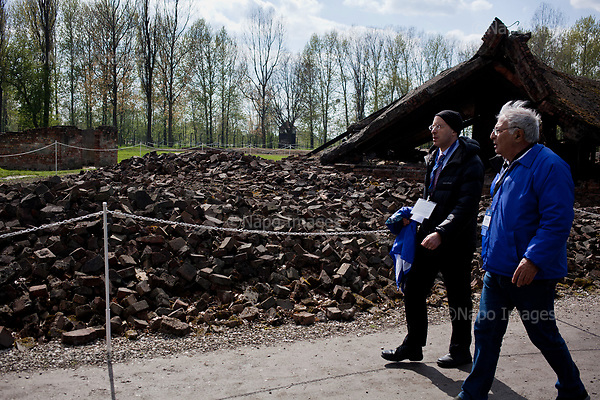 OSWIECIM, POLAND, APRIL 24, 2017:<br /> Elisha Wiesel and Sydney Amir are walking by the ruins of the crematorium at the camp in the &quot;March of The Living&quot; an annual march between two camps of the Auschwitz concentration camp.  Elisha Wiesel is a chief technology officer at Goldman Sachs in New York and the only son of Holocaust memoirist Eli Wiesel. After death of his father he has decided to step forward and take a more public role, carrying on his father's work.<br /> (Photo by Piotr Malecki / Napo Images)<br /> ###<br /> OSWIECIM, 24/04/2017:<br /> Elisha Wiesel, syn slawnego Eli Wiesela, bierze udzial w Marszu Zywych w Oswiecimiu. Po smierci ojca Elisha postanowil kontynuoawc jego dzielo.<br /> Fot: Piotr Malecki / Napo Images<br /> <br /> ###ZDJECIE MOZE BYC UZYTE W KONTEKSCIE NIEOBRAZAJACYM OSOB PRZEDSTAWIONYCH NA FOTOGRAFII###