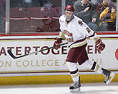 Brian Dumoulin (BC - 2) celebrates Hayes's goal.  Dumoulin earned a primary assist on the goal and three assists on the night. - The Boston College Eagles defeated the visiting University of Massachusetts-Lowell River Hawks 5-3 (EN) on Saturday, January 22, 2011, at Conte Forum in Chestnut Hill, Massachusetts.