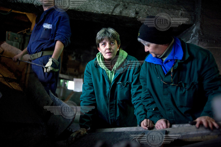 40 year old Cristina Mos. Although she has a qualification as a electrician she does unqualified work, at the Petrila mine, sorting coal from the stones. She only started working in the mine  a year before as a result of a mining accident that killed her brother-in-law. As a relative of  a miner killed at work, she was entitled to a job in the mine..