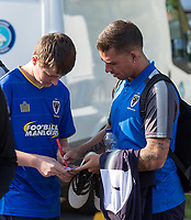 Cody McDonald of AFC Wimbledon with supporters ahead of the pre season friendly 'Cherry Red Records Cup' match between Wycombe Wanderers and AFC Wimbledon at Adams Park, High Wycombe, England on 25 July 2017. Photo by Andy Rowland.