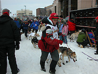 Jon Little.The first musher to depart Anchorage, Lori Townsend, takes her team to the starting line, March 4, 2006
