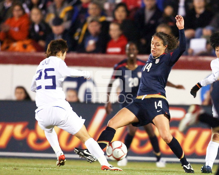 Stephanie Cox (14) of USA slides in to tackle Kim Yunji (25) of South Korea during an international friendly match at City Stadium on November 1, 2008 in Richmond, Virginia. USA won 3-1.