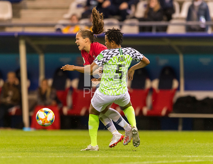 REIMS, FRANCE - JUNE 08: Guro Reiten #16 collides with Onome Ebi #5 during a game between Norway and Nigeria at Stade Auguste-Delaune on June 8, 2019 in Reims, France.