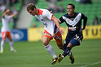 MELBOURNE, AUSTRALIA - SEPTEMBER 12, 2010: Ricardinho from the Victory grabs the shirt of Luke DeVere from the Roar in Round 6 of the 2010 A-League between the Melbourne Victory and Brisbane Roar at AAMI Park on September 12, 2010 in Melbourne, Australia. (Photo by Sydney Low / Asterisk Images)