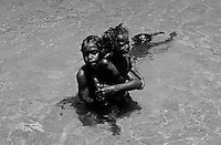 ABORIGINAL CHILDREN IN ARNHEM LAND BORDER KAKADU NATIONAL PARK