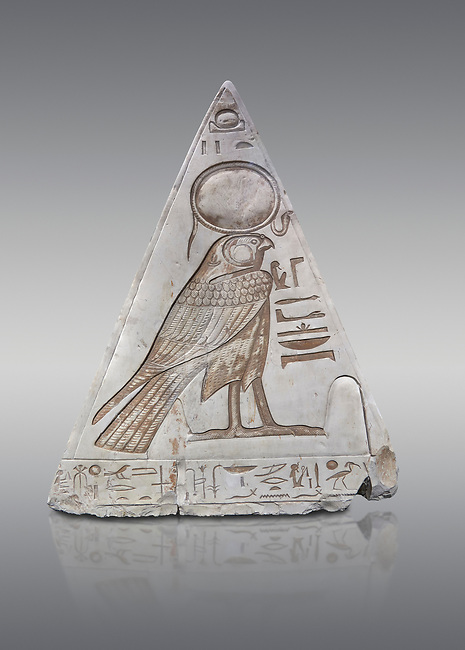 """South face of Ancient Egyptian Pyramidion of Ramose with depictionof Horus, Limestone, New Kingdom, 19th Dtnasty (1292-1190 BC), Dier el-Medina. Egyptian Museum, Turin. Old Fund cat 1603. Grey background.<br /> <br /> <br /> The South face of the Ramose Pyramidion shows Horus standing in a dipole magnetic field supporting the strong coronal electric field of the Sun. The hieroglyphs read:<br />  """"The Stellar dipole magnetic field is supported by many negative charges or electrons.""""<br /> The limestone Pyramidion of Ramose, from the top of the tomb of the 'Necropolis Scribe'. Scenes on all four sides depict the worship of the sun."""