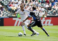 June 20, 2009: Bryan Jordan of Galaxy dribbles away from Ramiro Corrales of Earthquakes during a game at Coliseum in Oakland, California. San Jose Earthquakes defeated Los Angeles, 2-1
