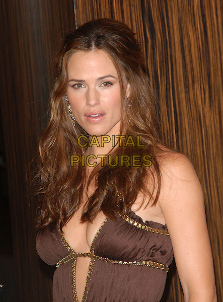 JENNIFER GARNER.attends The Hollywood Film Festival 10th Annual Hollywood Awards Gala held at The Beverly Hilton in Beverly Hills, California, USA, October 23rd 2006..half length brown and gold dress cut out cleavage low cut plunging neckline eyes to camera eye contact.Ref: DVS.www.capitalpictures.com.sales@capitalpictures.com.©Debbie VanStory/Capital Pictures