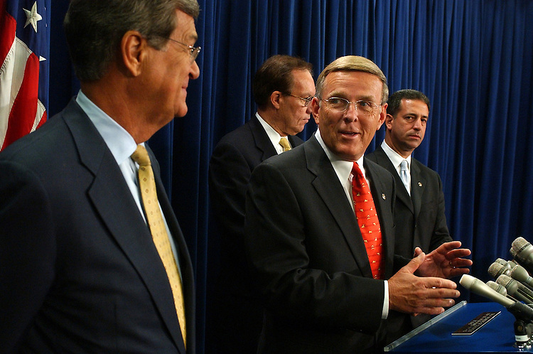 Sens. from left, Trent Lott, R-Miss., Wayne Allard, R-Colo., Byron Dorgan, D-N.D., (podium) and Russ Feingold, D-Wis., attend a news conference , reacting to the vote on the Congressional Resolution of Disapproval of new broadcast ownership rules approved by the Federal Communications Commission on June 2.