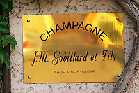 A brass sign : Champagne J.M. Gobillard et Fils SARL L'Altavilloise, the village of Hautvillers in Vallee de la Marne, Champagne, Marne, Ardennes, France