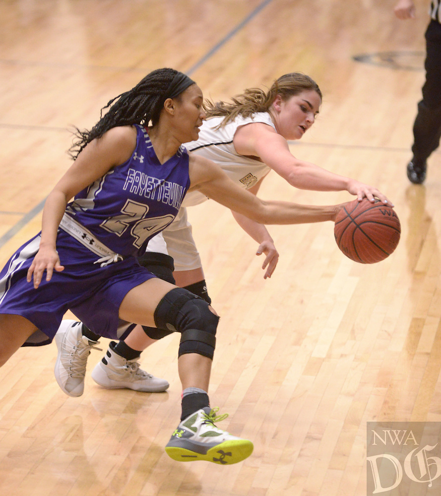 NWA Democrat-Gazette/BEN GOFF @NWABENGOFF<br /> Baylee Byford (right) of Bentonville tries to hang onto the ball as DaShundra Morgan of Fayetteville tries to steal on Friday Feb. 26, 2016 during the game in Bentonville's Tiger Arena.