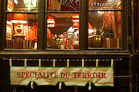 Strasburg, Alsace, France. Traditional restaurant window with a sign offering : Specialites '