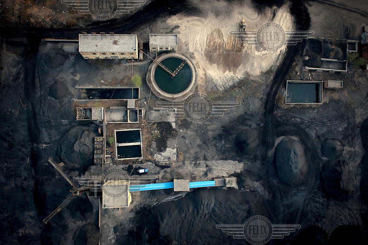 An industrial water treatment and mineral collecting area in Linzhou. /Felix Features