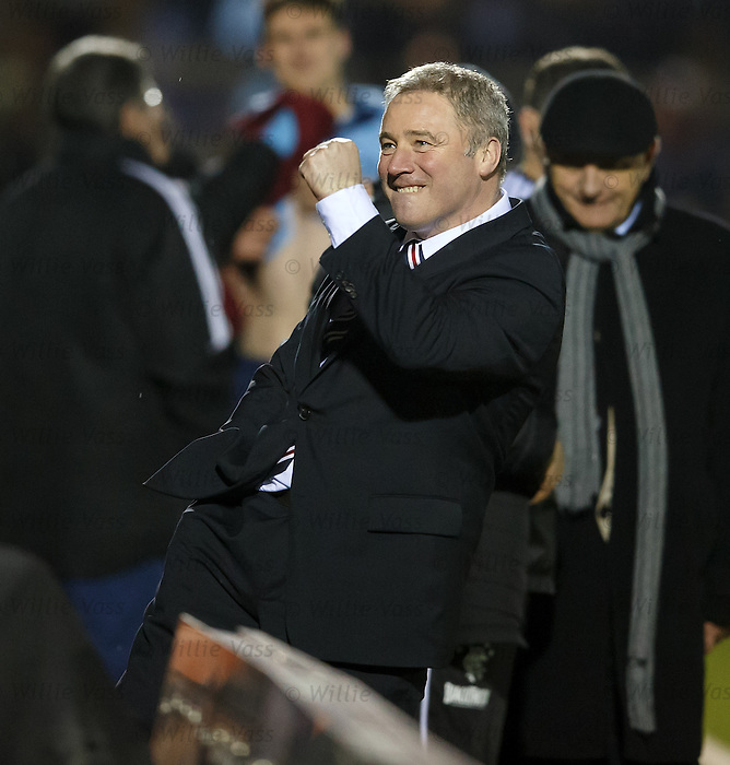Ally McCoist turns to the fans behind him and punches the air with delight as Rangers seal victory with two goals