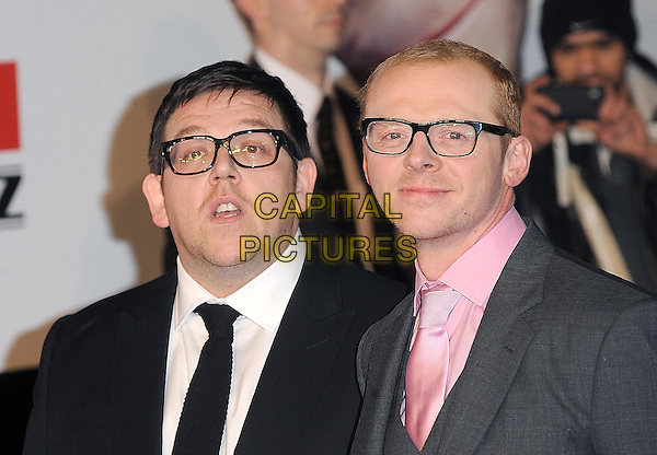 "NICK FROST & SIMON PEGG .The ""Paul"" UK Film Premiere, Empire Cinema, Leicester Square, London, England, UK,.7th February 2011..headshot portrait tie black white shirt glasses suit smiling mouth open grey gray pink .CAP/BEL.©Tom Belcher/Capital Pictures."