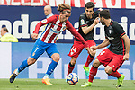 Antoine Griezmann (L)  of Atletico de Madrid fights for the ball with Markel Susaeta Laskurain (C) and Mikel Balenziaga Oruesagasti  (R) of Athletic Club during their La Liga match between Atletico de Madrid vs Athletic de Bilbao at the Estadio Vicente Calderon on 21 May 2017 in Madrid, Spain. Photo by Diego Gonzalez Souto / Power Sport Images