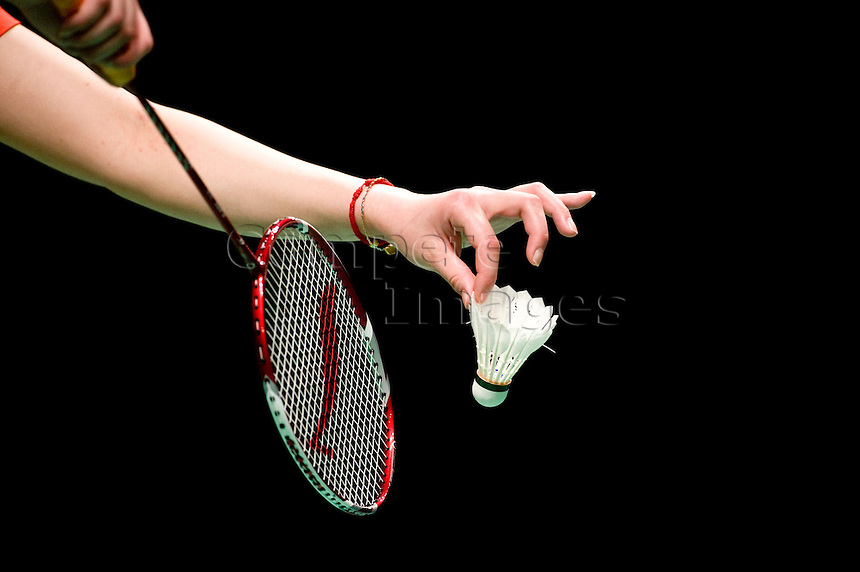 Shuttle-cock is served by a women in game of badminton