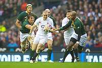 Mike Brown of England accelerates past Eben Etzebeth (left) and JP Pietersen of South Africa during the QBE Autumn International match between England and South Africa at Twickenham on Saturday 24 November 2012 (Photo by Rob Munro)