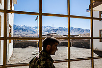 Chak District HQ, CHAK VALLEY, WARDAK PROVINCE, AFGHANISTAN - NOVEMBER 12, 2013: An A.N.A. soldier walks past the glassless windows of the Chak District HQ during a re-supply mission in the Chak valley on November 12, 2013 in Wardak Province, Afghanistan. 600 ANA soldiers advanced through the Chak valley, a haven for Taliban and insurgent fighters, to re-supply a base for the winter.           Photo by Daniel Berehulak for the New York Times.