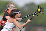 Minooka's Maggie Struthers (left) fights for the ball carried by O'Fallon's Adler Maher. O'Fallon played Minooka in a quarterfinal game of the O'Fallon sectional at O'Fallon Sports Park on Monday May 20, 2019. <br /> Tim Vizer/Special to STLhighschoolsports.com