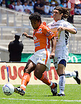 UNAM Pumas striker Bruno Marioni (R) fights for the ball with Chiapas Jaguares Melvin Brown during their soccer match at the University Stadium, April 02, 2006. UNAM Pumas won 2-1 to Chiapas Jaguares... Photo by © Javier Rodriguez