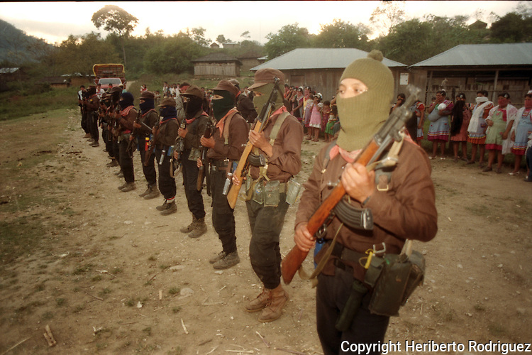 Zapatista troops present arms as Subcomandante Marcos reviews troops in La Garrucha village in the Lacandonian jungle in southern state of Chiapas, March 22, 1994.  Photo by Heriberto Rodriguez