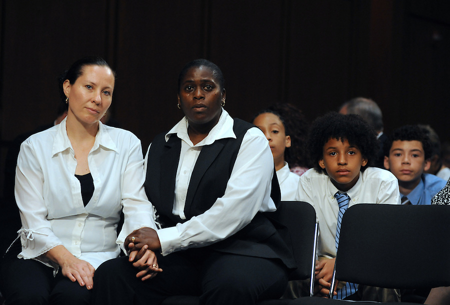 """Geraldine and Suzanne Artis, of Clinton, Conn., hold hands during a hearing entitled """"S.598, The Respect for Marriage Act: Assessing the Impact of DOMA on American Families."""" Solmonese is among the witnesses to testify in the hearing. The Artis' have been together for 17 years and have three sons (left to right) Zanagee, 11, Gezani, 11, and Geras, 13."""