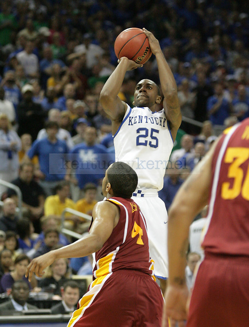 UK freshman point guard Marquis Teague shoots a three-point shot during the second half of the UK vs. Iowa State NCAA third round game at the KFC Yum! Center March 17, 2012. Photo by Brandon Goodwin | Staff