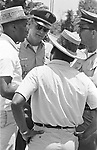 Dr. Robert Smith and Martin Luther King Jr consult with Officers of the Mississippi State Troopers, along route of 2nd Meredith March Against Fear through Mississippi photographed by Jim Peppler for essay published in The Southern Courier on June 25, 1966. Copyright Jim Peppler/1966. .This and over 10,000 other images are part of the Jim Peppler Collection at The Alabama Department of Archives and History:  http://digital.archives.alabama.gov/cdm4/peppler.php