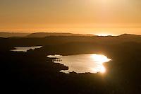 Lake Mueller atop an ancient glacier moraine along the coastline near Fox Glacier Village - Westland National Park, West Coast, New Zealand