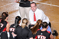 22 November 2008:  Western Kentucky University Volleyball Head Coach Travis Hudson speaks with his team during a timeout in the WKU 3-0 victory over New Orleans in the championship game of the Sun Belt Conference tournament at U.S. Century Bank Arena in Miami, Florida.