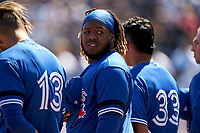 Toronto Blue Jays Vladimir Guerrero Jr. (27) during the national anthem before a Spring Training game against the New York Yankees on February 22, 2020 at the George M. Steinbrenner Field in Tampa, Florida.  (Mike Janes/Four Seam Images)