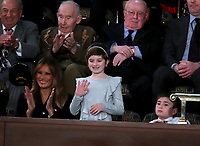 Grace Eline, who was diagnosed with Germinoma, a germ-cell brain tumor, waves to the audience after being introduced by United States President Donald J. Trump during his second annual State of the Union Address to a joint session of the US Congress in the US Capitol in Washington, DC on Tuesday, February 5, 2019.  Grace recently finished chemotherapy and currently shows no evidence of the disease.  First lady Melania Trump applauds at left.  Joshua Trump, a sixth grader who was bullied at school because of his last name is pictured at right.<br /> Credit: Alex Edelman / CNP/AdMedia
