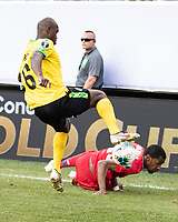 PHILADELPHIA, PA - JUNE 30: Dever Orgill #6 takes the ball from Michael Murillo #23 during a game between Panama and Jamaica at Lincoln Financial Field on June 30, 2019 in Philadelphia, Pennsylvania.