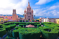Overview of the main square (Plaza Principal) with the Church of St. Michael the Archangel in background, San Miguel de Allende, Mexico
