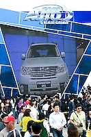 A crowd of visitors populates Shanghai Motor Show, in Shanghai, China, on April 25, 2009. Shanghai auto show opened Monday for the press and will be open April 24-28 for the public. China is the only major auto market still growing despite the global economic slowdown. U.S. and global auto makers see China as the place where they can find the sales they desperately lack in their home market. Chinese automakers see the opportunity to assess themselves as major players in the world market. Photo by Lucas Schifres/Pictobank