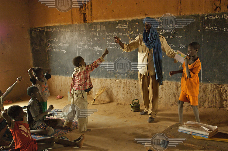 Abouleacrine ag Tadima teaches children basic health in his classroom in the village of Intedeyne. Children's education remains a major challenge for Mali, which has the highest percentage of people living below the poverty line of any country in the world, with female literacy rates 50 percent lower than that of men...