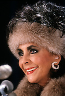 "Helmsley Palace Hotel, New York - January 14, 1987. This portrait of Elizabeth Taylor was taken at the press conference held by the Cheseborough Pond Company for the actress's new fragrance, Elizabeth Taylor's Passion. Elizabeth ""Liz"" Taylor (February 27, 1932 – March 23, 2011) was a British-American actress, who became one of the great screen actresses of Hollywood's Golden Age."