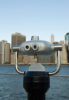 AVAILABLE FROM GETTY IMAGES FOR LICENSING.  Please go to www.gettyimages.com and search for image # 141112703.<br /> <br /> Lower Manhattan Financial District Skyline Viewed from Brooklyn Bridge Park with  Coin Operated Binoculars, New York City, New York State, USA