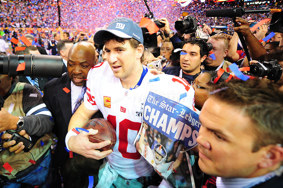 Feb 5, 2012; Indianapolis, IN, USA; New York Giants quarterback Eli Manning (10) celebrates after Super Bowl XLVI against the New England Patriots at Lucas Oil Stadium. The Giants defeated the Patriots 21-17. Mandatory Credit: Mark J. Rebilas-