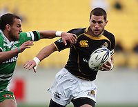 Manawatu first five Aaron Cruden tries to tackle Cory Jane. Air NZ Cup - Wellington Lions v Manawatu Turbos at Westpac Stadium, Wellington, New Zealand. Saturday 3 October 2009. Photo: Dave Lintott / lintottphoto.co.nz
