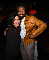 "LOS ANGELES - FEBRUARY 19: Pamela Adlon and Donald Glover at the party for FX's ""Atlanta Robbin' Season"" at the Clifton Cafeteria on February 19, 2018 in Los Angeles, California.(Photo by Frank Micelotta/FX/PictureGroup)"