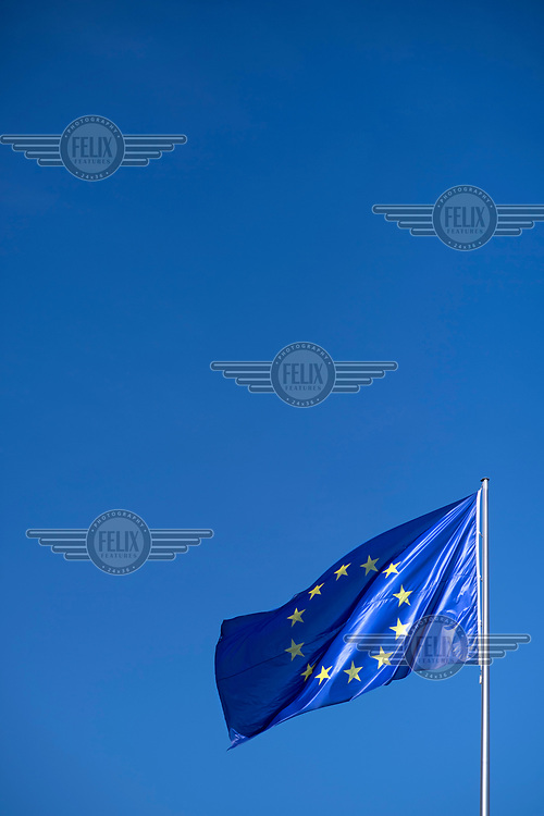 The European flag flying over the Chancellery.