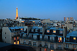The night view of Eiffel Tower La tour eiffel over residential buildings.City of Paris. Paris. France